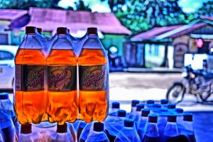 View through Tropical Soda from the grocery store onto the street!