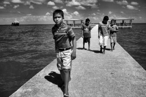 Honduran boys on the jetty.